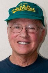 Micky thinks wearing an A's hat is daring; he's a Giants fan