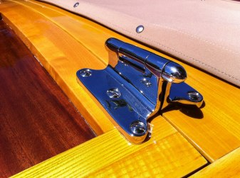 The massive chrome hinge on the trunk.