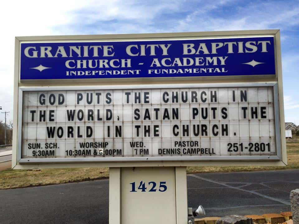 granite city baptist church sign that says God puts the church in the world, satan puts the world in the church