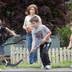 mom with kids playing hockey