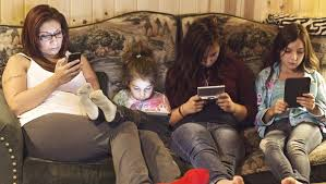 family with iphones