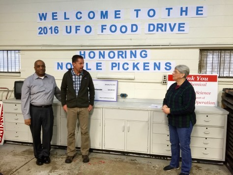 Andy Altman, center, explains Dow Chemical Company's support for United Food Operation by providing the building, including all maintenance and utilities.