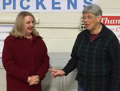 The contributions of Frontier Communication are recognized by UFO's Elaine Harris. On left is XXX ZZZZZZ of Frontier's West Virginia operations.