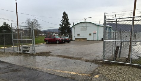 """The gate and entrance to United Food Operation""""s new headquarters, as viewed from Route 25."""