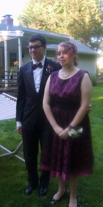 Prom dress of magenta taffeta with black lace overlay and satin sash