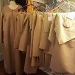 Sewn production of men's robes for a theatrical group.