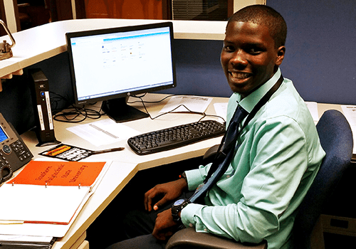 Dahnvonta, a Youth Employment Program summer intern, at his workspace at JEA.