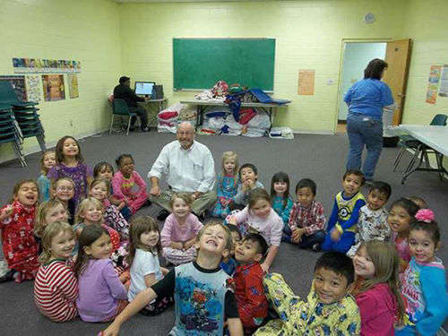 ReadingPal Jim Riggan with just one of the preschool classes he visits as a volunteer reader.