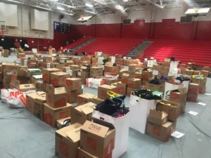School supplies collected from Stuff the Bus covered the gymnasium floor at Andrew Jackson High School.