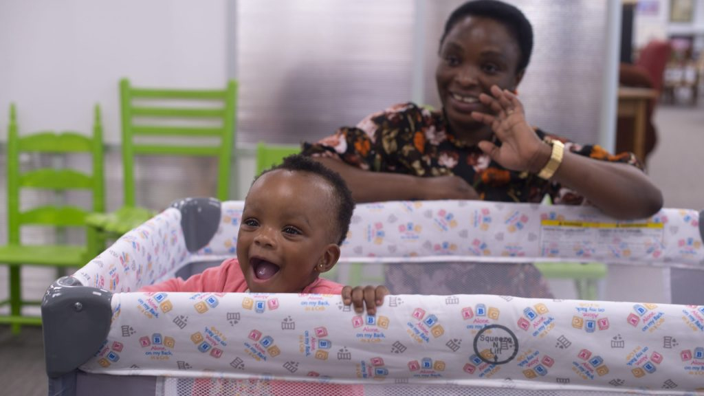 Baby enjoys crib at The Green Chair Project