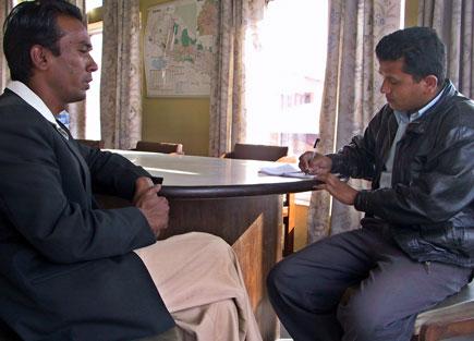 Santosh Kumar Mahato talking to Balkrishna Basnet