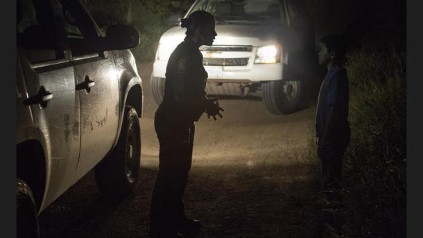 U.S. Border Patrol agent Marlene Castro, left, talks with an unaccompanied Honduran boy last month.  (Brian van der Brug / Los Angeles Times)