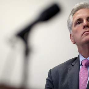 McCarthy stares down immigration protesters