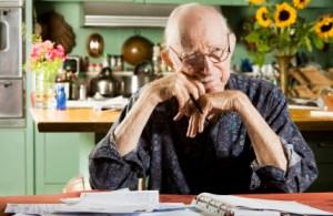 Elder Man at Home with Bills