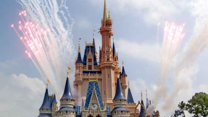 fireworks in sky over fairy tale castle in amusement park