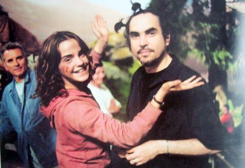 """During each scene, Emma Watson wanted to play with director Alfonso's long hair. She even put pigtails in his hair. """"I'm his unofficial hairdresser,"""" she says.-  Harry Potter and Prisoner of Azkaban Behind the Scenes"""