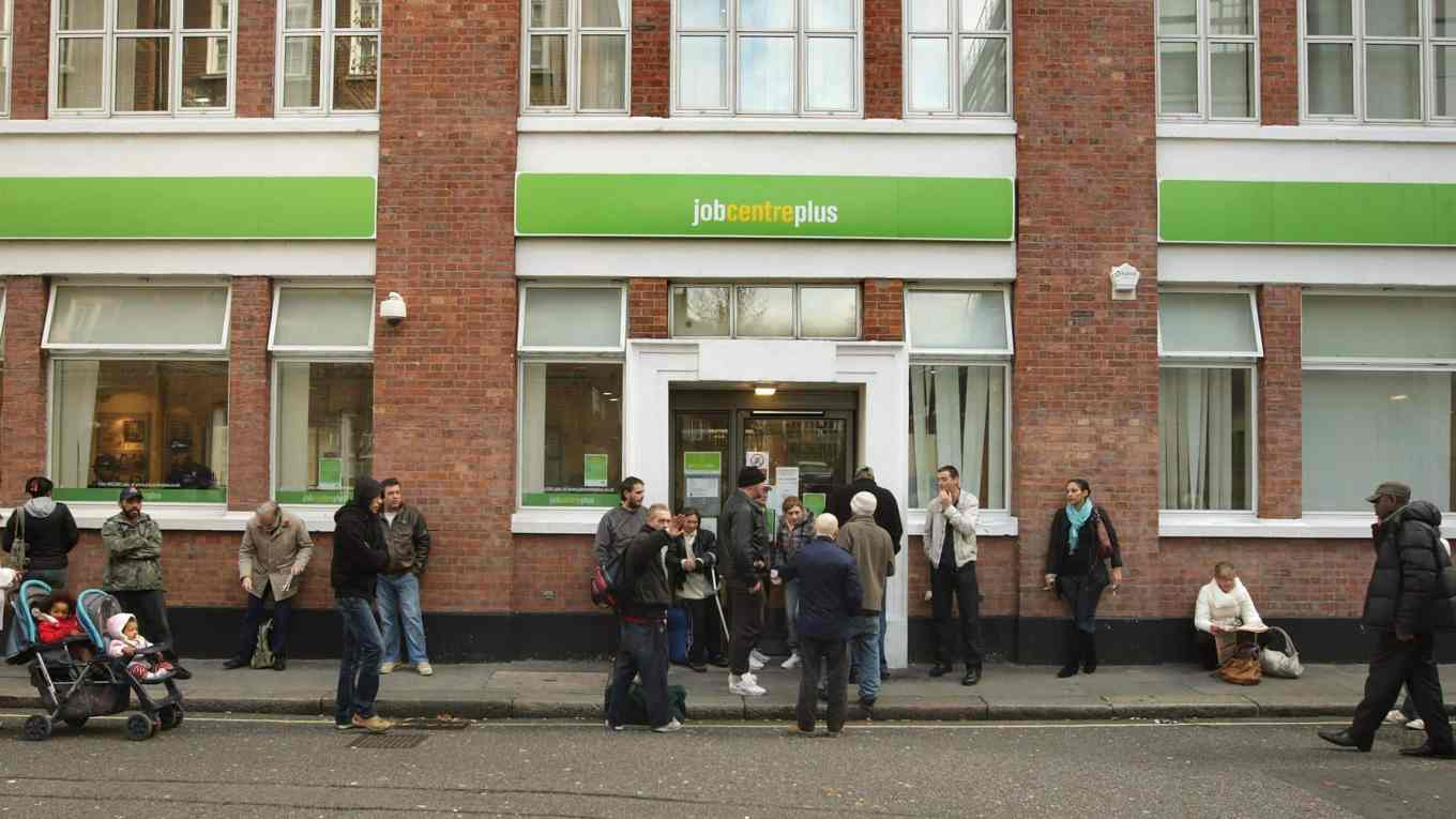 Jobseekers queuing outside a Jobcentre Plus