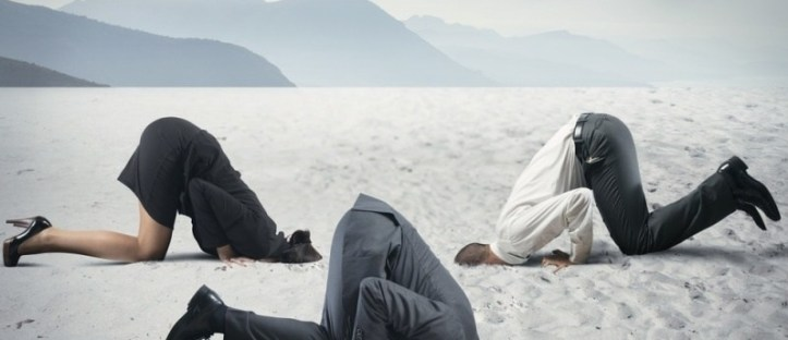 Business-people-in-denial-with-heads-in-sand-via-Shutterstock-800x430