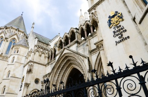 The Victorian Gothic style main entrance to the The Royal Courts of Justice public building in London, UK, opened in 1882. shutterstock