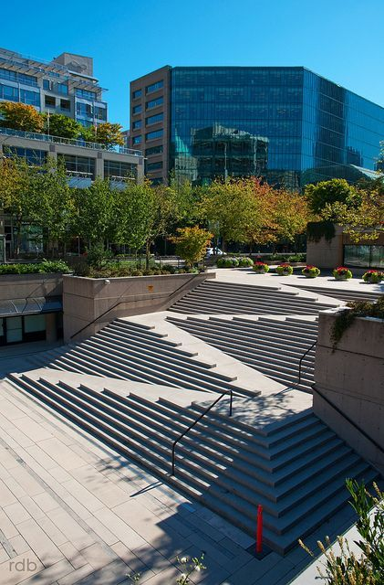 Robsen Square stramp showing how a ramp is integrated into stairs showing the four switchbacks and a few sets of hand rails on the outer edges.