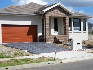 A new home showing the entry with six steps to the front door. It is not accessible.