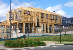 House half built showing timber framework. Universal design in housing. The time has come.