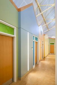 picsture of a corridor in a large building with calm colours and natural lighting