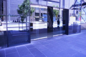Photo showing visual distortion and reflections in a glass door