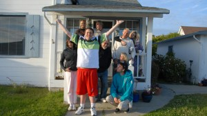 Picture of a large family looking jubilant outside their house