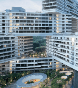 Picture of the Interlace showing how eight storey apartment blocks can be stacked at angles besides and and top of each other.