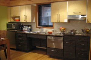 picture of a kitchen with a lowered section of kitchen bench with sink and kneespace below