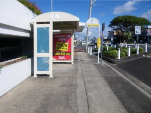 Picture of a bus stop and bus shelter and footpath