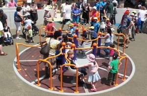 Distance shot of children on a carousel or spinner