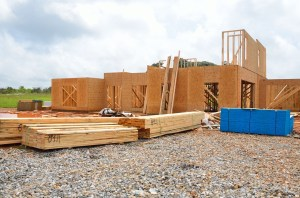 new home construction site with timber on the ground