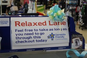 A large sign at a supermarket checkout lane saying in red lettering, Relaxed Lane, feel free to take as long a you need