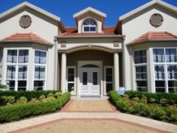 Facade of a large two storey home commonly called a McMansion