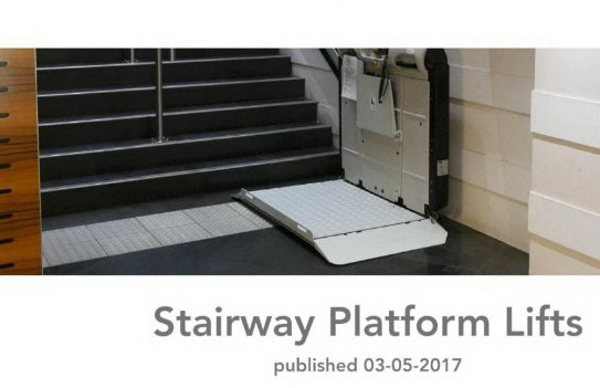 open platform lift at the bottom of a stairway