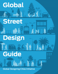 Front cover of the guide. It is blue with white text. It has outlines of pedestrians trees, buildings and transport