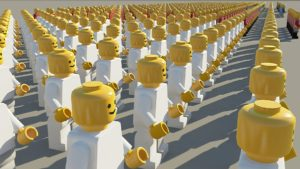 A crowd of lego people all in white with yellow heads.