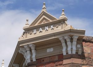 Looking upwards to the gable of a federation building with the name Bank on it