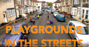 A suburban street in Bristol with cars parked on both sides of the road. Children are playing in the street.