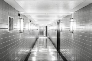 corridor with a shiny floor, brightly lit, but it looks wet