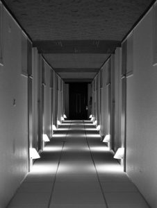 hallway with lighting across the floor making it look like steps