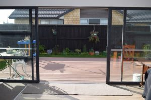 Sliding doors opening to a decked area but also having level entry.