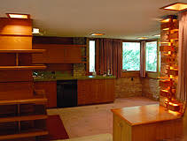 A view of the open plan kitchen. The home has a lot of timber in the construction and the furniture.