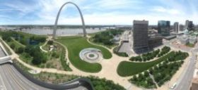 A distant aerial view of the huge arch and the park and landscaping