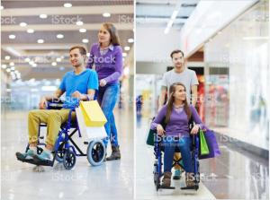 Shutterstock image of a young person being pushed in a hospital wheelchair. The occupant is obviously a model that doesn't look like they have a disability.