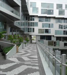Apartments in shades of grey are linked by a graded pathway to provide accessibility.