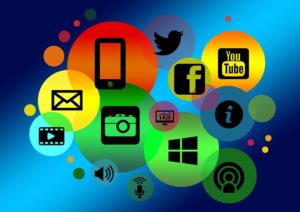A brightly coloured graphic indicates different kinds of digital communication: social media, camera, phone and video.