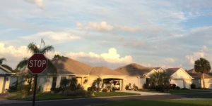 Single storey homes in the late afternoon sun suggesting a retirement community.